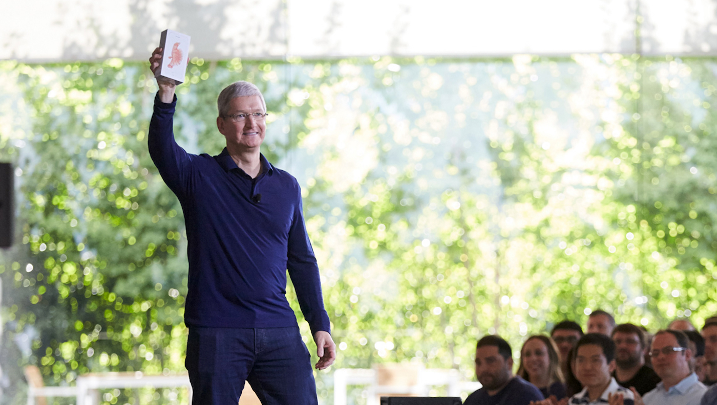 Tim Cook holds the billionth iPhone at an employee meeting in Cupertino. Photo Apple.