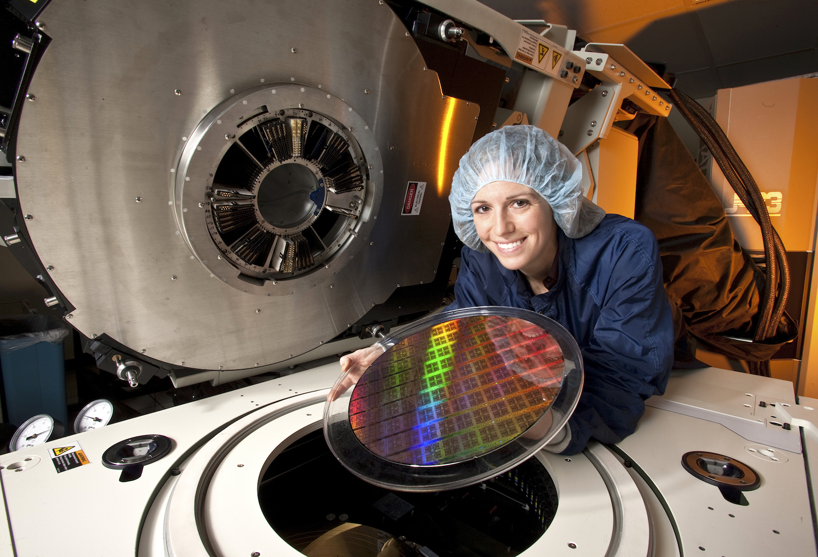 IBM Test Engineer Sara Lestage holds a 300mm Power 7 processor wafer, 2010.
